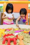 Asian Chinese Little Sister Playing Kinetic Sand Indoor Royalty Free Stock Image