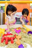 Asian Chinese Little Sister Playing Kinetic Sand Indoor Stock Photography