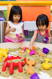 Asian Chinese Little Sister Playing Kinetic Sand Indoor Royalty Free Stock Photos