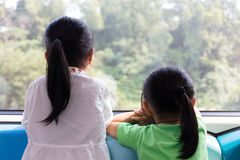 Asian Chinese little sisters inside a MRT transit Royalty Free Stock Photography