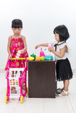 Asian Chinese little sisters pretending customer and cashier wit Stock Images
