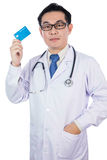 Asian Chinese male doctor holding credit card with stethoscope Royalty Free Stock Image