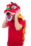 Asian Chinese man perform lion dance celebrating Chinese New Yea Stock Images
