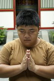Asian chinese man praying Stock Photography