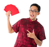 Asian Chinese man showing many red packets Stock Photos