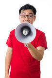 Asian Chinese man wearing red shirt holding loudspeaker Royalty Free Stock Photography