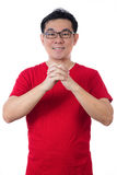 Asian Chinese man wearing red shirt showing congratulation gestu Stock Photography