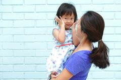 Asian Chinese mother carrying daughter stock images