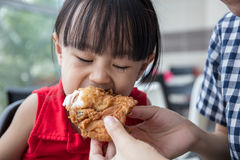 Asian Chinese mother and daughter eating fried chicken Stock Photo