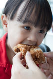 Asian Chinese mother and daughter eating fried chicken Royalty Free Stock Photo
