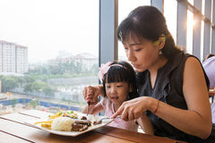 Asian Chinese mother and daughter eating steak Stock Photography