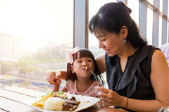 Asian Chinese mother and daughter eating steak Stock Photos