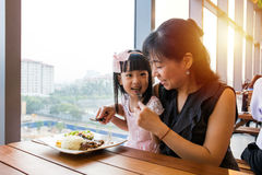 Asian Chinese mother and daughter eating steak Royalty Free Stock Image
