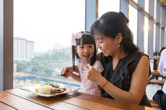 Asian Chinese mother and daughter eating steak Stock Image