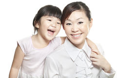 Asian Chinese mother with daughter family portrait. Shot against white studio background Royalty Free Stock Photography