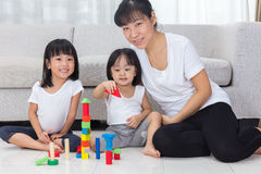Asian Chinese mother and daughter playing blocks on the floor Royalty Free Stock Photography