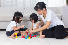 Asian Chinese mother and daughter playing blocks on the floor Royalty Free Stock Photo
