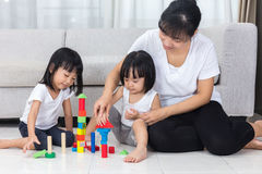 Asian Chinese mother and daughter playing blocks on the floor Stock Photos