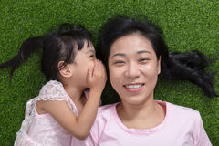 Asian Chinese mother and daughter whispering and gossiping Stock Photos
