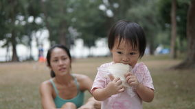 Asian chinese mother supervising her child outdoor Royalty Free Stock Photography