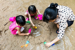 Asian Chinese mum and daughter playing sand together Stock Photo