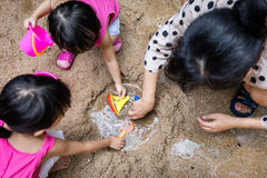 Asian Chinese mum and daughter playing sand together Royalty Free Stock Photography