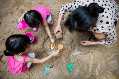 Asian Chinese mum and daughter playing sand together Royalty Free Stock Photos
