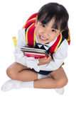 Asian Chinese primary school girl sitting on the floor Royalty Free Stock Photo