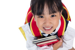 Asian Chinese primary school girl sitting on the floor Stock Photo
