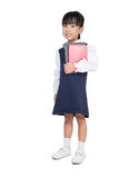 Asian Chinese primary school girl in uniform holding books Royalty Free Stock Photo