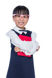 Asian Chinese primary school girl in uniform holding books Stock Photo