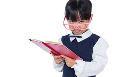 Asian Chinese primary school girl in uniform reading book Stock Images