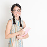Asian Chinese school girl hands holding text books Royalty Free Stock Images