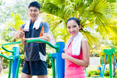 Asian Chinese sport friends in outdoor fitness gym royalty free stock image