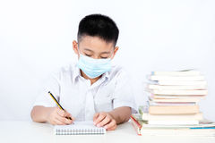 Asian Chinese Student Boy Writing with Protection Mask Stock Images