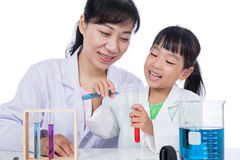 Asian Chinese teacher and little student girl working with test Royalty Free Stock Photography