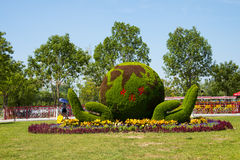 Asian Chinese, Tianjin Wuqing, Green Expo,Landscape flower beds, grass carving, Hand, earth Royalty Free Stock Photography