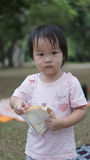 Asian chinese toddler eating her sandwich Stock Photo