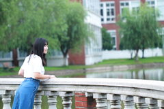Asian Chinese university student enjoy free time at campus Stock Image