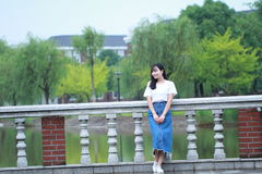Asian Chinese university student enjoy free time at campus Royalty Free Stock Photography