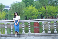 Asian Chinese university student enjoy free time at campus Stock Photo