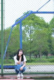 Asian Chinese university student enjoy free time at campus Royalty Free Stock Photo