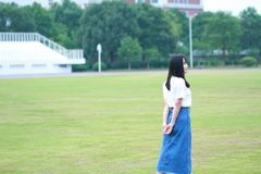 Asian Chinese university student play on the grandstand Royalty Free Stock Photography