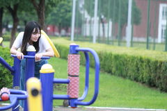 Asian Chinese university student play on the playground Stock Image