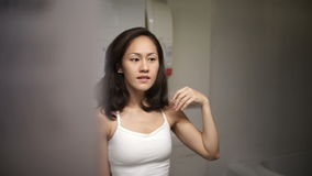 Asian chinese woman admiring herself in the mirror Royalty Free Stock Photo