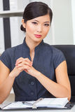 Asian Chinese Woman or Businesswoman in her Office Stock Photography