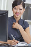 Asian Chinese Woman or Businesswoman in Office Royalty Free Stock Photo