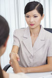 Asian Chinese Woman or Businesswoman Shaking Hands Royalty Free Stock Photo