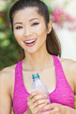 Asian Chinese Woman Exercising Drinking Bottle of Water Stock Photo