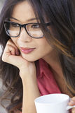Asian Chinese Woman Girl in Glasses Drinking Coffee Stock Image